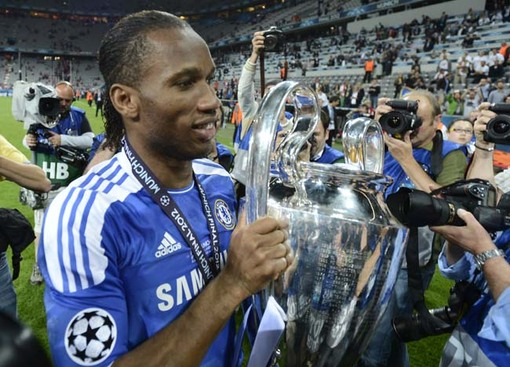 Drogba of Chelsea holds the UEFA Champions League trophy after his team's final soccer match against Bayern Munich at the Allianz Arena in Munich